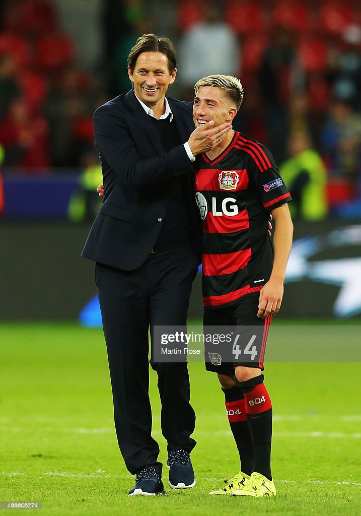 Roger Schmidt, coach of Bayer Leverkusen celebrates with Kevin Kampl of Bayer Leverkusen after the UEFA Champions League Group E match between Bayer 04 Leverkusen and FC BATE Borisov at BayArena on September 16, 2015 in Leverkusen, Germany.