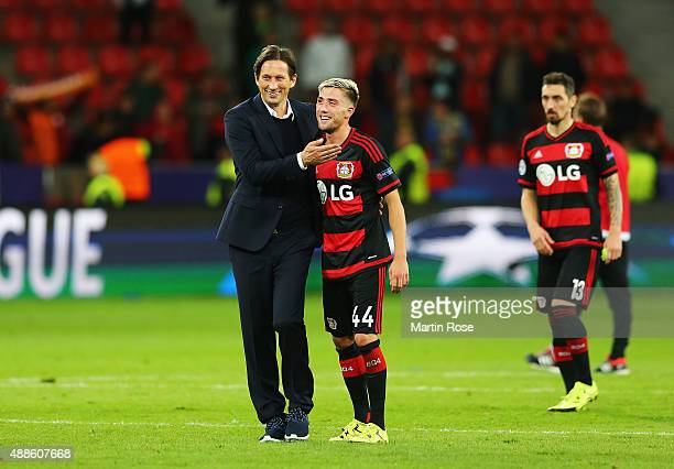 Roger Schmidt coach of Bayer Leverkusen celebrates with Kevin Kampl of Bayer Leverkusen after the UEFA Champions League Group E match between Bayer...