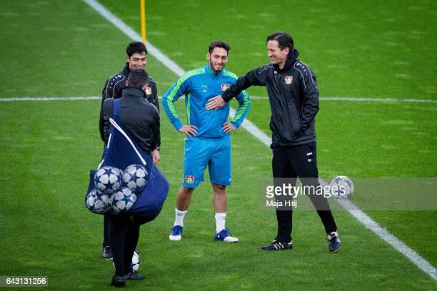 Roger Schmidt head coach and Hakan Calhanoglu of Leverkusen joke during the training prior the UEFA Champions League Round of 16 first leg match...