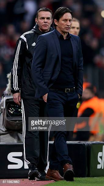 Roger Schmidt head coach of Bayer Leverkusen looks on next to fourth official Christoph Bornhorst during the Bundesliga match between Bayer...