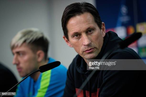 Roger Schmidt head coach of Leverkusen and Kevin Kampl attend the press conference prior the UEFA Champions League Round of 16 first leg match...