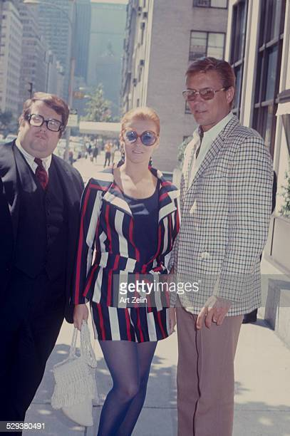 Roger Smith with AnnMargret with their agent outside the Regency circa 1970 New York