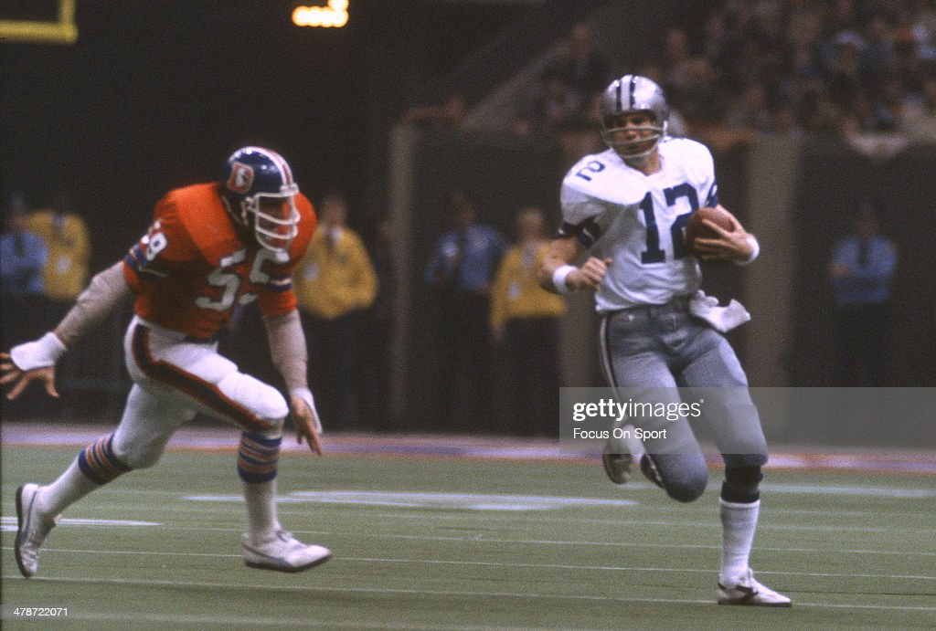 Roger Staubach #12 of the Dallas Cowboys scrambles with the ball against the Denver Broncos during Super Bowl XII on January 15, 1978 at the Louisiana Super dome in New Orleans, Louisiana. The Cowboys won the Super Bowl 27-10.