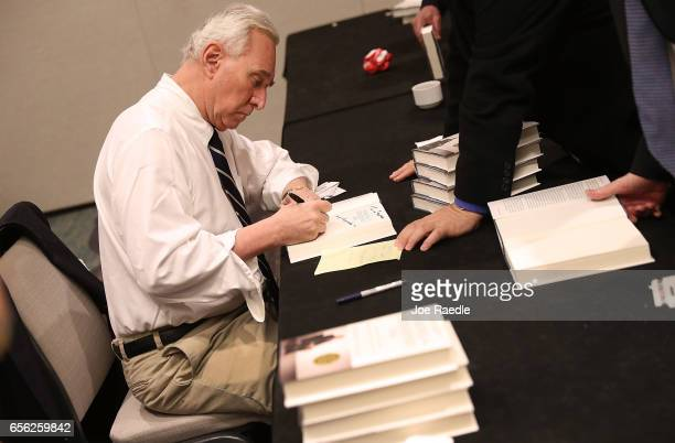 Roger Stone a longtime political adviser and friend to President Donald Trump signs copies of his book 'The Making of the President 2016' at the Boca...