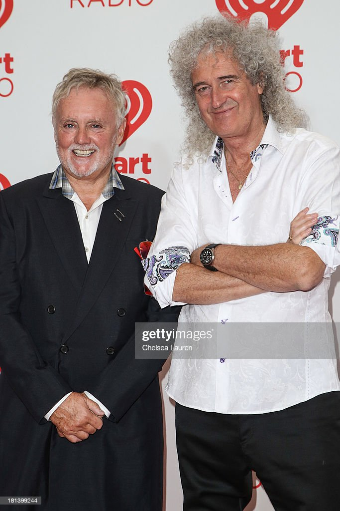 Roger Taylor (L) and Brian May of Queen of Queen pose in the iHeartRadio music festival photo room on September 20, 2013 in Las Vegas, Nevada.