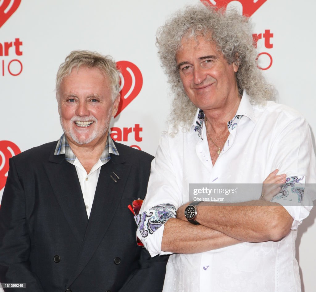 Roger Taylor (L) and <a gi-track='captionPersonalityLinkClicked' href=/galleries/search?phrase=Brian+May&family=editorial&specificpeople=158059 ng-click='$event.stopPropagation()'>Brian May</a> of Queen of Queen pose in the iHeartRadio music festival photo room on September 20, 2013 in Las Vegas, Nevada.