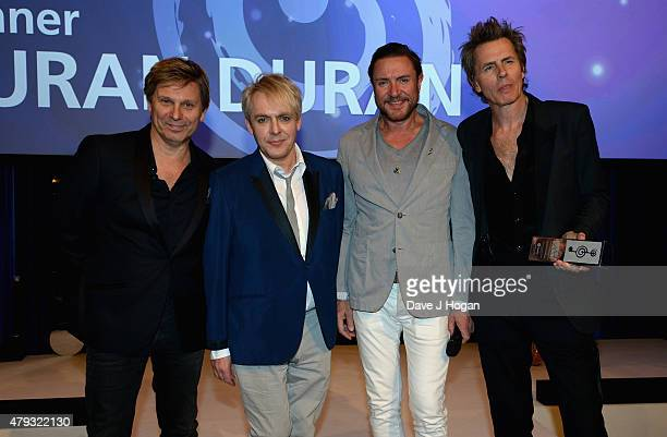 Roger Taylor Nick Rhodes Simon Le Bon and John Taylor from Duran Duran with their Lifetime Achievement award at the Nordoff Robbins O2 Silver Clef...
