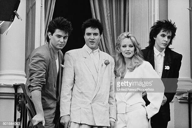 Roger Taylor Simon Le Bon and Nick Rhodes from Duran Duran posed with American actress Tanya Roberts at a press call to promote the James Bond film...