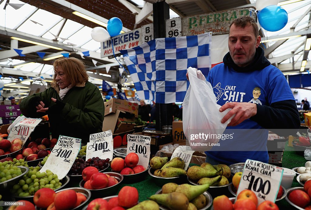 Roger Toon (R) of 'Linekers' fruit and veg stall shows their support towards Leicester City FC during a Leicester Backing the Blues Campaign in support of Leicester City on April 29, 2016 in Leicester, England.
