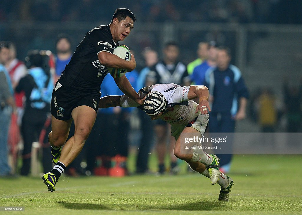 Roger Tuivasa Scheck of New Zealand slips the tackle of Theo Fages during the Rugby League World Cup group B match between New Zealand and France at Parc des Sports on November 1, 2013 in Avignon, France.