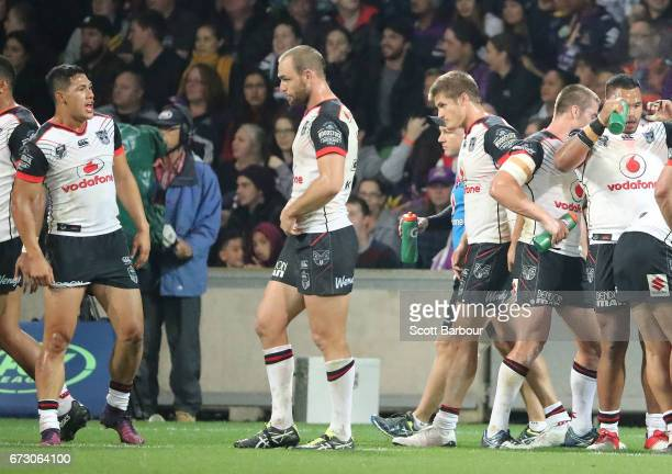 Roger TuivasaSheck and the Warriors stand behind their line after conceeding a try during the round eight NRL match between the Melbourne Storm and...