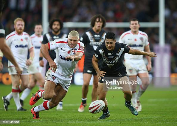 Roger TuivasaSheck of New Zealand battles for the ball with Ryan Hall of England during the International Rugby League Test Series match between...