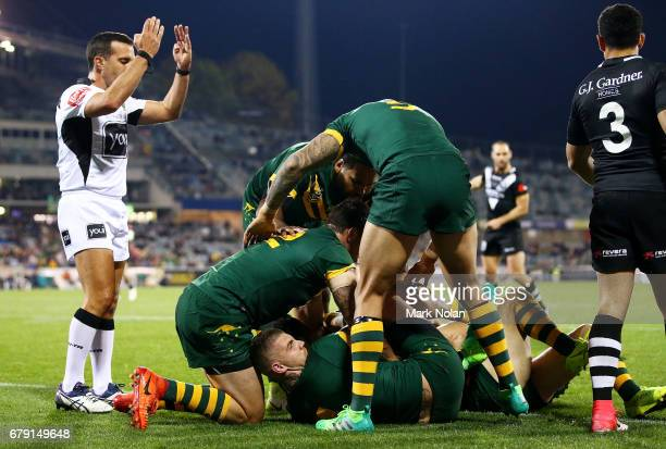 Roger TuivasaSheck of the Kiwis is held up over the try line during the ANZAC Test match between the Australian Kangaroos and the New Zealand Kiwis...