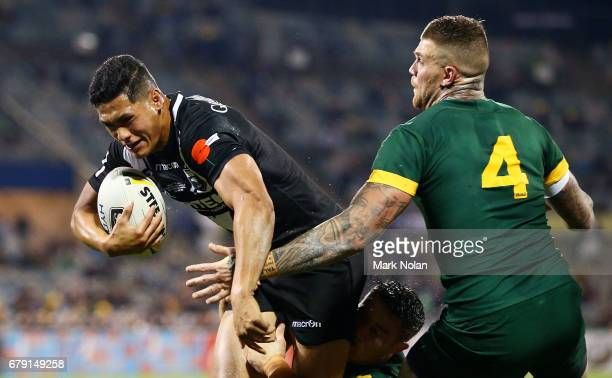 Roger TuivasaSheck of the Kiwis is tackled during the ANZAC Test match between the Australian Kangaroos and the New Zealand Kiwis at GIO Stadium on...