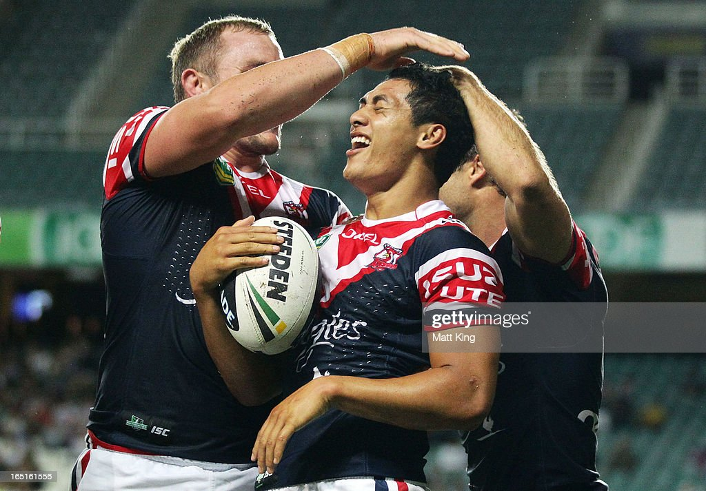 Roger Tuivasa-Sheck (C) of the Roosters celebrates with team mates after scoring a try in the corner during the round four NRL match between the Sydney Roosters and the Parramatta Eels at Allianz Stadium on April 1, 2013 in Sydney, Australia.