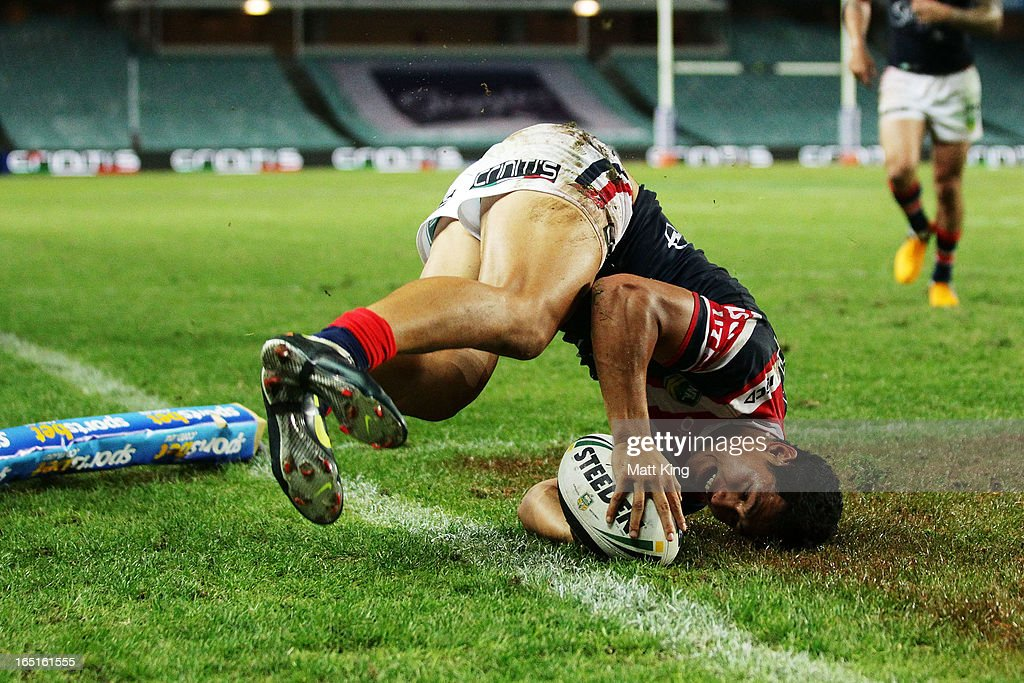 Roger Tuivasa-Sheck of the Roosters dives overe to score a try in the corner during the round four NRL match between the Sydney Roosters and the Parramatta Eels at Allianz Stadium on April 1, 2013 in Sydney, Australia.