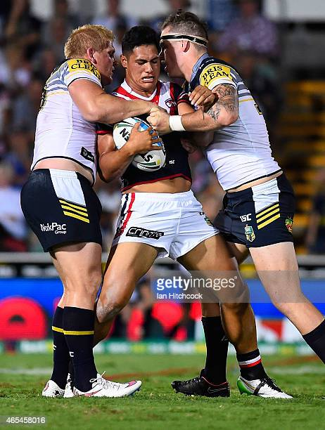 Roger TuivasaSheck of the Roosters is tackled by Ben Hannant of the Cowboys and Ethan Lowe of the Cowboys during the round one NRL match between the...