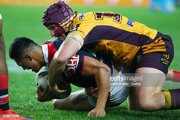 Roger TuivasaSheck of the Roosters is tackled by Bronco's Matt Gillett during the round 24 match between Sydney Roosters and Brisbane Broncos at...