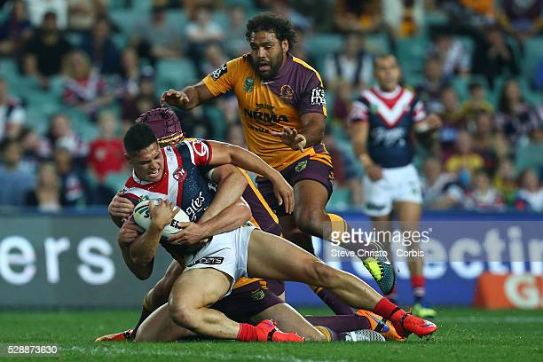 Roger TuivasaSheck of the Roosters is tackled by Bronco's Matt Gillett and Sam Thaiday during the round 24 match between Sydney Roosters and Brisbane...