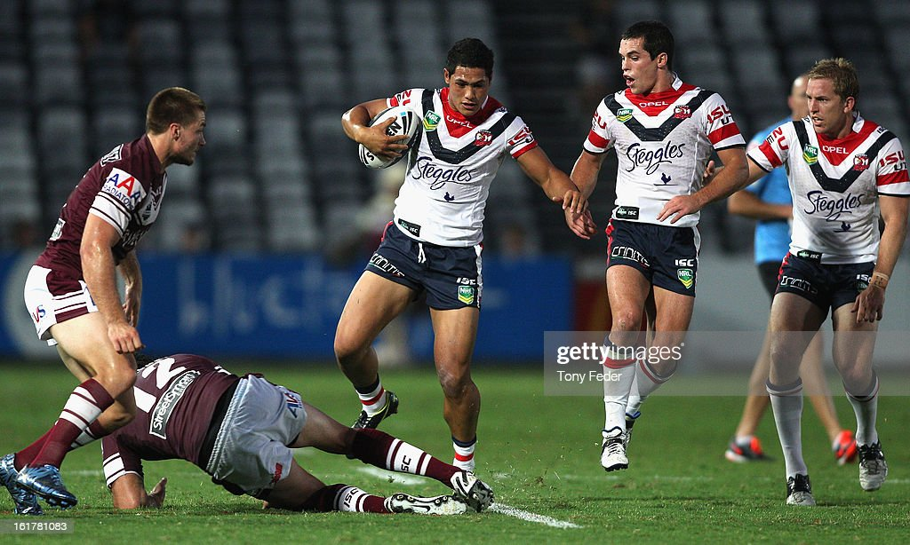 Roger Tuivasa-Sheck of the Roosters makes a run with the ball during the NRL trial match between the Manly Sea Eagles and the Sydney Roosters at Bluetongue Stadium on February 16, 2013 in Gosford, Australia.