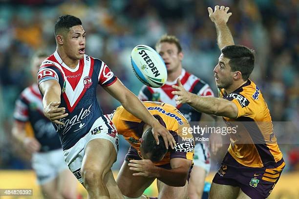 Roger TuivasaSheck of the Roosters passes during the round 24 NRL match between the Sydney Roosters and the Brisbane Broncos at Allianz Stadium on...