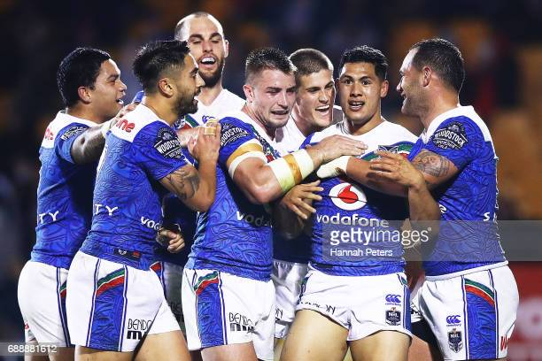 Roger TuivasaSheck of the Warriors celebrates with his team after scoring a try during the round 12 NRL match between the New Zealand Warriors and...