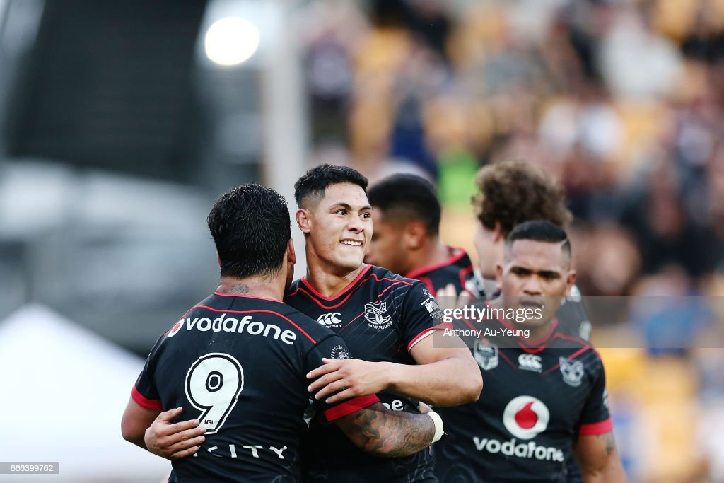 Roger Tuivasa-Sheck of the Warriors celebrates with teammate Issac Luke after Ken Maumalo's try during the round six NRL match between the New Zealand Warriors and the Parramatta Eels at Mt Smart Stadium on April 9, 2017 in Auckland, New Zealand.