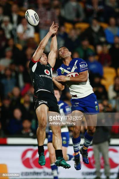 Roger TuivasaSheck of the Warriors competes for the high ball against Will Hopoate of the Bulldogs during the round 16 NRL match between the New...