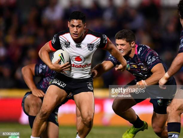 Roger TuivasaSheck of the Warriors gets past Corey Jensen of the Cowboys during the round 20 NRL match between the North Queensland Cowboys and the...
