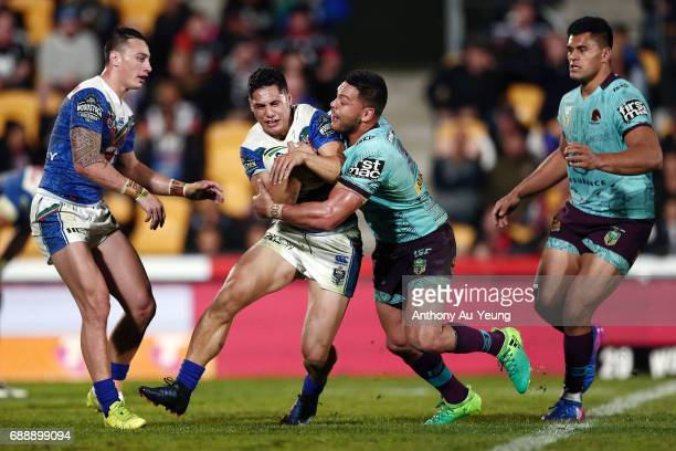 Roger TuivasaSheck of the Warriors is tackled by Alex Glenn of the Broncos during the round 12 NRL match between the New Zealand Warriors and the...