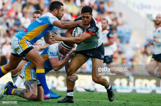 Roger TuivasaSheck of the Warriors is tackled by Jarryd Hayne during the round 14 NRL match between the Gold Coast Titans and the New Zealand...