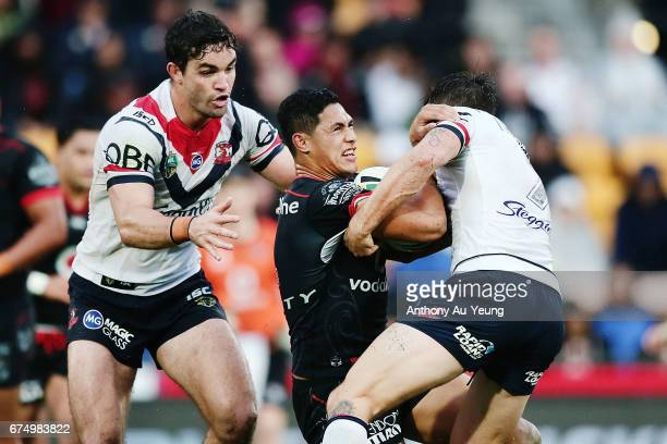 Roger TuivasaSheck of the Warriors is tackled by Mitchell Pearce and Aidan Guerra of the Roosters during the round nine NRL match between the New...