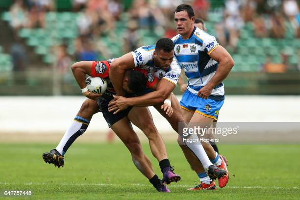 Roger TuivasaSheck of the Warriors is tackled by Ryan James of the Titans during the NRL Trial match between the Warriors and the Gold Coast Titans...