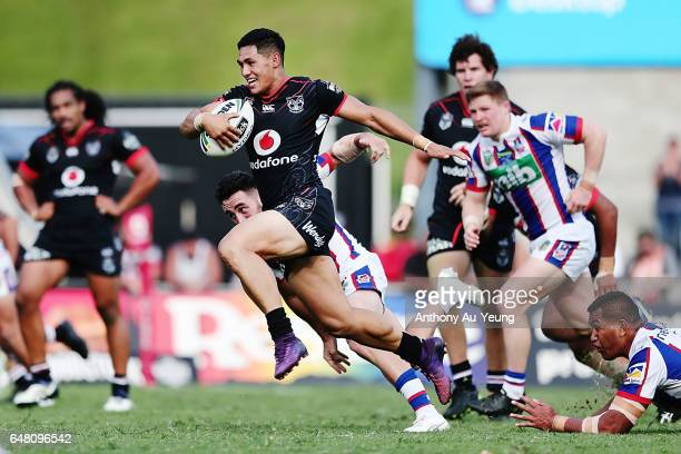 Roger TuivasaSheck of the Warriors makes a break during the round one NRL match between the New Zealand Warriors and the Newcastle Knights at Mt...