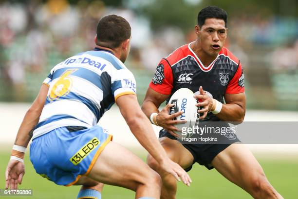 Roger TuivasaSheck of the Warriors runs at Ash Taylor of the Titans during the NRL Trial match between the Warriors and the Gold Coast Titans at...