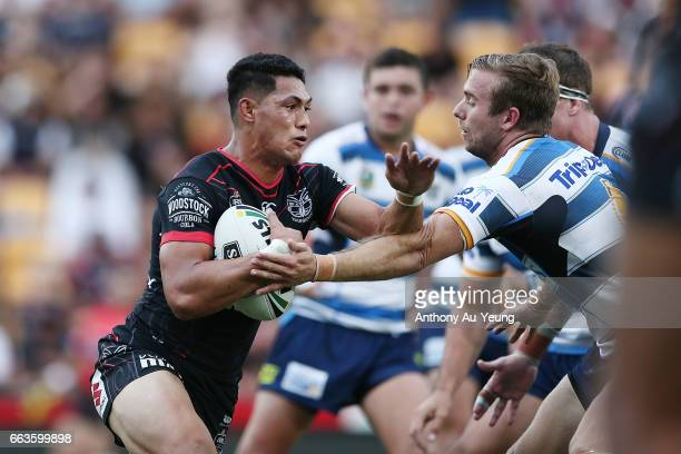 Roger TuivasaSheck of the Warriors runs the ball at Kane Elgey of the Titans during the round five NRL match between the New Zealand Warriors and the...