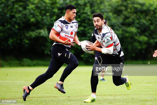 Roger TuivasaSheck runs through drills with Shaun Johnson during a New Zealand Warriors NRL training session at Mt Smart Stadium on April 21 2017 in...