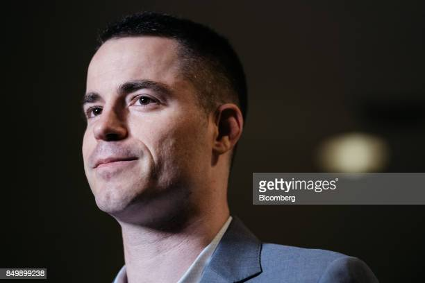Roger Ver chief executive officer of Bitcoincom listens during a Bloomberg Television interview on the sidelines of the Shape the Future Blockchain...