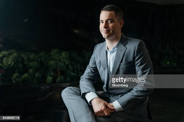 Roger Ver chief executive officer of Bitcoincom poses for a photograph at the Shape the Future Blockchain Global Summit in Hong Kong China on...