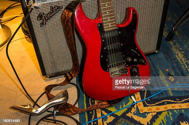 Roger Vivier shoe is seen next to the guitar and amplifier of singer Jef Barbara's musician during the Vogue Fashion Night Out event at Roger Vivier...