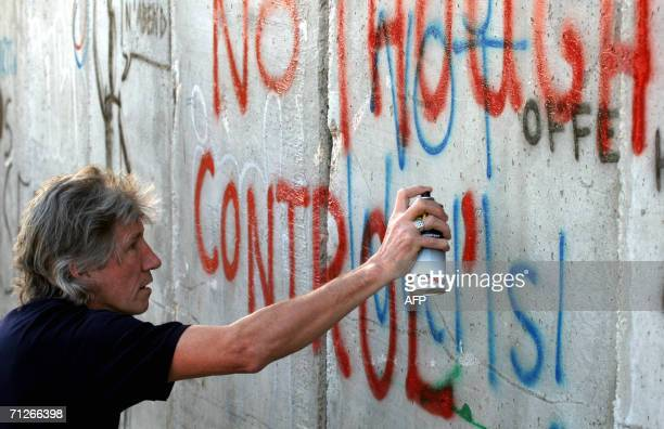 Roger Waters British rock legend and co founder of the group Pink Floyd paints a graffiti at Israels separation barrier surrounding the West Bank...