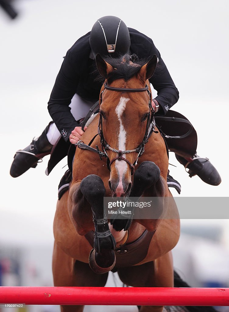 Roger Yves Bost of France hangs on to Qoud' Coeur de la Loge during the Longines Global Champions Tour of London on Day Four at Olympic Park on June 9, 2013 in London, England.