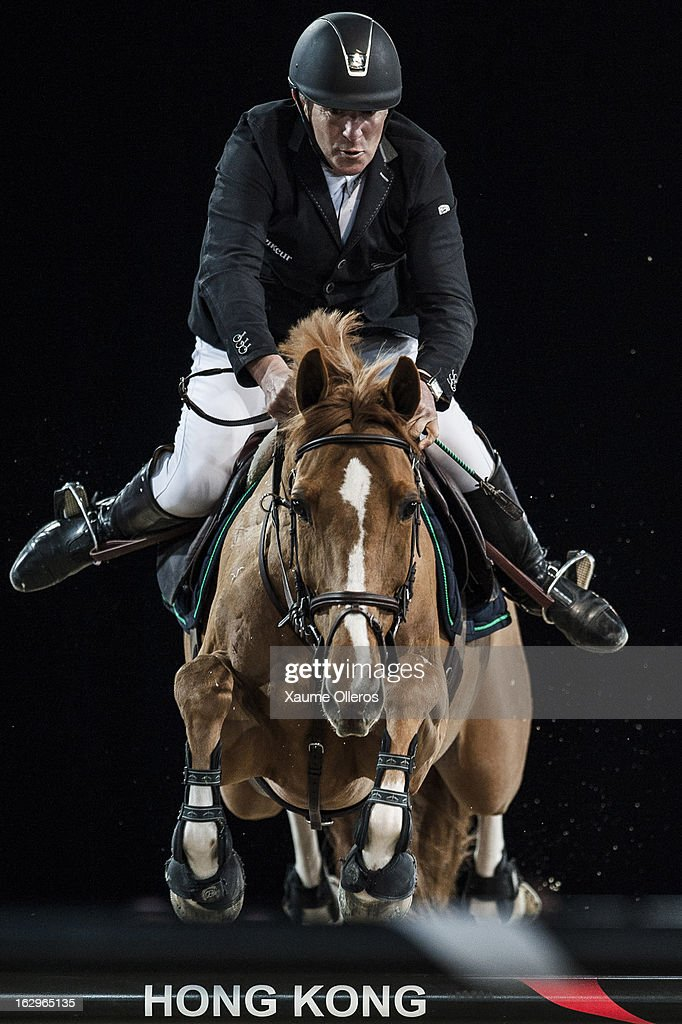 Roger Yves Bost of France rides Castle Forbes Cosma at the Longines Grand Prix during the Longines Hong Kong Masters International Show Jumping at Asia World Expo on March 2, 2013 in Hong Kong, Hong Kong.