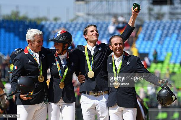 Roger Yves Bost of France riding Sydney Une Prince Penelope Leprevost of France riding Flora de Mariposa Kevin Staut of France riding Reveur de...