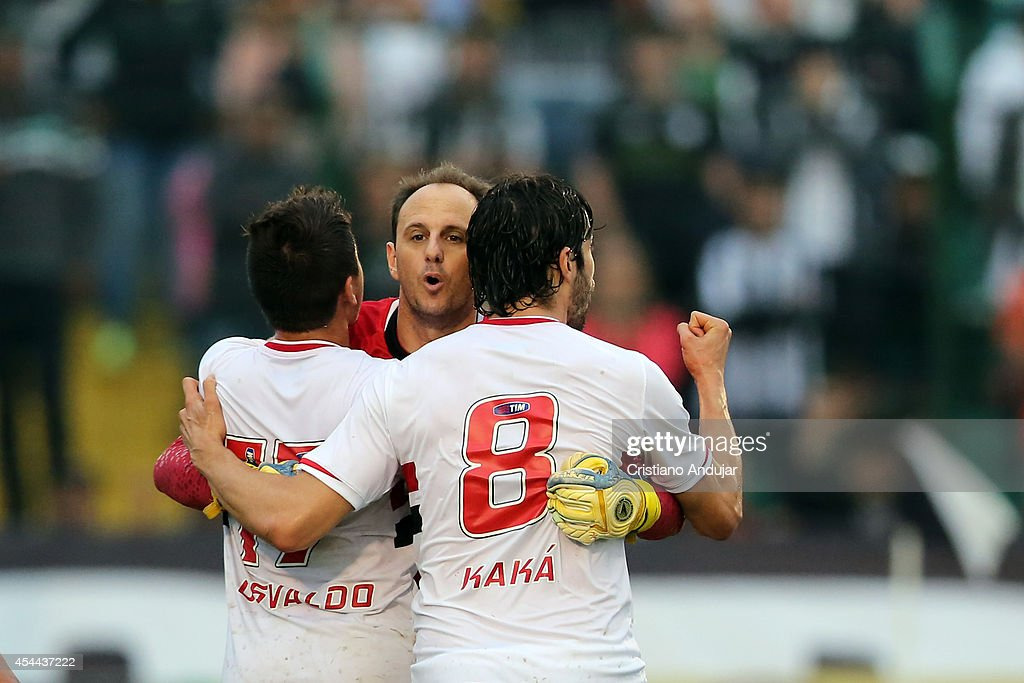 <a gi-track='captionPersonalityLinkClicked' href=/galleries/search?phrase=Rogerio+Ceni&family=editorial&specificpeople=490994 ng-click='$event.stopPropagation()'>Rogerio Ceni</a> #1 of Sao Paulo celebrate his goal with Osvaldo #17 and Kaka #8, segond of match, scored by penalty kick during a match between Figueirense and Sao Paulo as part of Campeonato Brasileiro 2014 at Orlando Scarpelli Stadium on August 31, 2014 in Florianopolis, Brazil