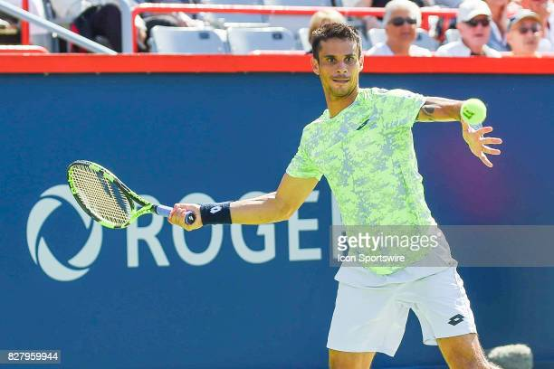 Rogerio Dutra Silva returns the ball while making eye contact with it during his first round match at ATP Coupe Rogers on August 8 at Uniprix Stadium...