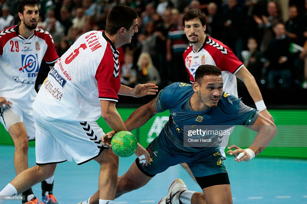 Rogerio Ferreira (R) of Brazil challenges for the ball with <a gi-track='captionPersonalityLinkClicked' href=/galleries/search?phrase=Zarko+Sesum&family=editorial&specificpeople=5668700 ng-click='$event.stopPropagation()'>Zarko Sesum</a> (L) of Serbia during the Handball Supercup between Brazil and Serbia on November 8, 2015 in Kiel, Germany.