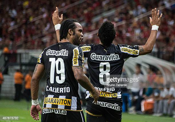 Rogerio of Botafogo and celebrates his first goal which Wallyson of Botafogo and Carlos Alberto of Botafogo during the Brasileirao Series A 2014...