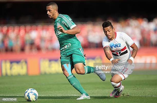 Rogerio of Sao Paulo fights for the ball with Victor Hugo of Palmeiras during the match between Sao Paulo and Palmeiras for the Brazilian Series A...