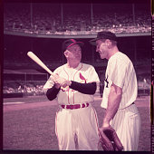 Rogers Hornsby right gives a few pointers to Yankee's Hank Bauer before Hall of Fame game at Yankee Stadium